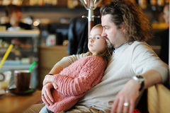 Father and his daughter relaxing in cafe Royalty Free Stock Photo