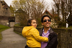 The father and his daughter on the road Stock Photography