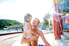 Father with his daughter in swimming pool. Sunny summer. Royalty Free Stock Photography