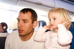 Father with his daughter travel by plane Royalty Free Stock Photo