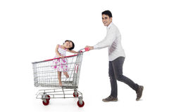 Father with his daughter on trolley Stock Photo