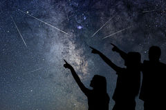 Father and his daughter are watching Meteor Shower. Night sky. Stock Images