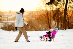 Father and his daughters having fun on winter Royalty Free Stock Photos