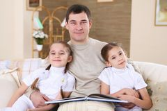 Father with his daughters at home Royalty Free Stock Images