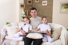 Father with his daughters at home Stock Photo