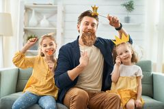 Father and his daughters with a paper accessories stock images