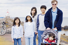 Father with his five children at lake Royalty Free Stock Image