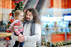 Father and his girl in shopping mall on Christmas Royalty Free Stock Image
