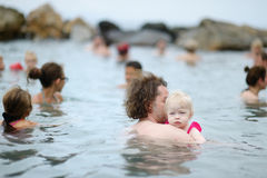 Father and his kid relaxing in hot spring Royalty Free Stock Photos