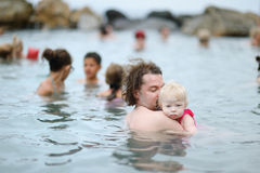 Father and his kid relaxing in hot spring Stock Photo