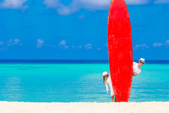 Father and his kid with surfboard during summer Stock Photos