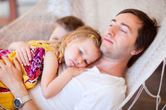 Father and his kids relaxing in hammock Stock Photography
