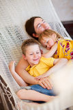 Father and his kids relaxing in hammock Royalty Free Stock Image
