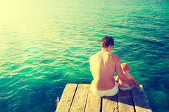 Father with His Little Baby Relaxing by the Sea Royalty Free Stock Photo