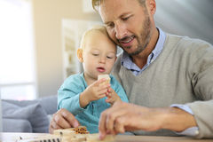 Father and his little boy playing together Stock Photos