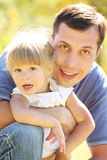 Father with his little daughter on nature Royalty Free Stock Image