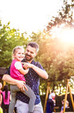 Father with his little daughter outside in park Royalty Free Stock Photography