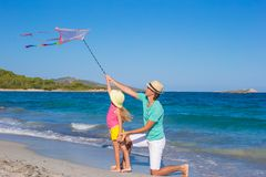 Father and his little daughter playing with a kite Stock Photography