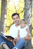 Father with his little daughter reads the Bible Stock Image