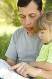 Father with his little daughter reads the Bible Royalty Free Stock Images