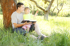Father with his little daughter reads the Bible Royalty Free Stock Image