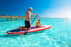 Father with his little happy son having fun on stand up paddle board, Corsica, France Royalty Free Stock Photos