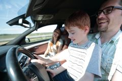 Father and his little son driving a car. The concept of parenting Royalty Free Stock Photography