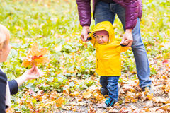 Father and his little son having fun in autumn park Royalty Free Stock Photography