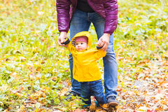 Father and his little son having fun in autumn park.  Royalty Free Stock Photo