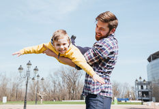 Father and his little son playing together in a park Stock Photo