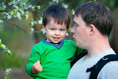 Father and his little son in spring park Stock Photos