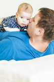 Father and His Newborn Child Together. Indoors shot. Royalty Free Stock Photo