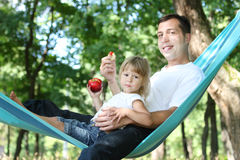 Father with his small daughter in a hammock Royalty Free Stock Image