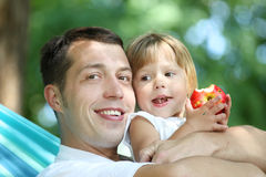 Father with his small daughter in a hammock Royalty Free Stock Photos