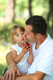 Father with his small daughter in a hammock Royalty Free Stock Photography