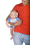 Father and his small son. A young father and his small son in the white background Royalty Free Stock Images