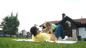 Father with his small son playing in the grass on the summer park. stock video footage