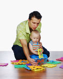The father and his son. The father is playing with his child Royalty Free Stock Photography