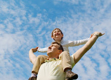 The father and his son. Against the blue sky Stock Photos
