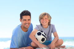 Father and his son with a ball Stock Photography