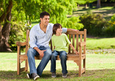 Father with his son on the bench Royalty Free Stock Image