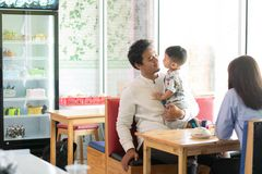 Father and his son bonding at indoors bakery and cake store in the morning. Father and his son bonding at indoors  bakery and cake store in the morning. family stock image