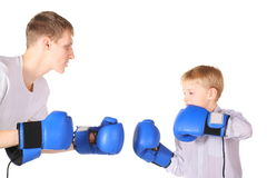 Father and his son is boxing with boxing gloves Stock Photo