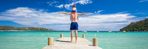 Father with his son on the bridge on Santa Giulia beach, Corsica, France Stock Image