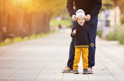 Father with his son in a city park Stock Photography