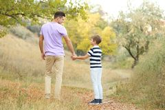 Father and his son. In countrye stock photo