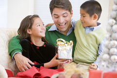 Father And His Son And Daughter Sitting On Sofa Stock Photography