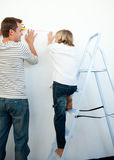 Father and his son decorating a room Stock Images