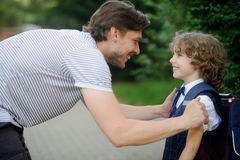 Father with his son-first-graders in the school yard. Stock Photos