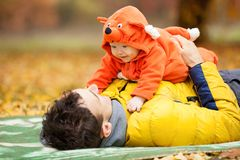 Father and his son in fox costume Stock Photo